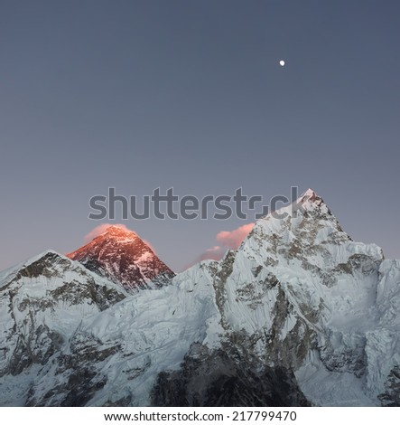 Mt. Everest (8848 m) and Nuptse (7864 m) peaks in the last light of the Sun - Nepal, Himalayas - stock photo