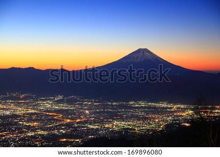 Mt. Fuji and Kofu city at dawn, Yamanashi, Japan  - stock photo
