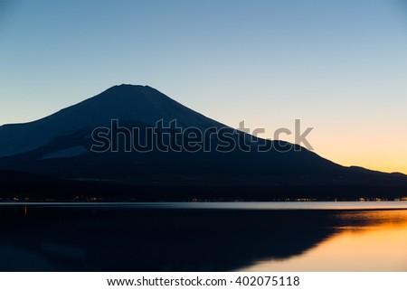 Mt. Fuji and Lake Yamanaka at evening - stock photo