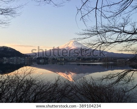 Mt Fuji in the early morning with reflection on the lake kawaguchiko - stock photo