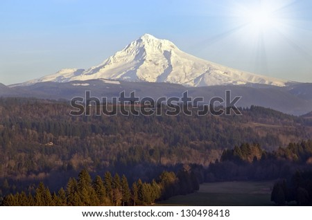 Mt Hood from Sandy river - stock photo