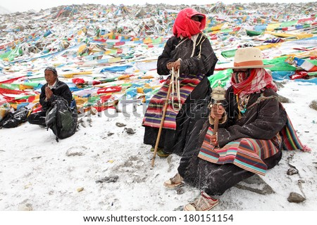 MT. KAILASH, TIBET, CHINA � JUNE 3, 2012: Buddhist pilgrims praying at Drolma La pass near holy Mt. Kailash  - stock photo