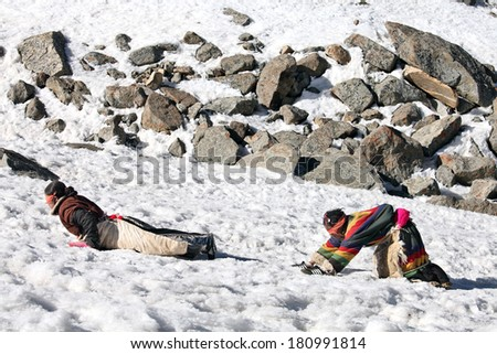 Mt Kailash, Tibet, China - May 26, 2012: Buddhist woman pilgrims making the kora (circumambulation) around Mt. Kailash and performing full body prostrations - stock photo