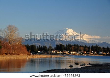 Mt. Rainier at sunset beyond Lake Tapps, south of Seattle, Washington - stock photo