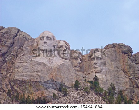 Mt. Rushmore, South Dakota.  The Mount Rushmore National Memorial is a sculpture carved into the granite face of Mount Rushmore near Keystone, South Dakota, in the United States.  - stock photo