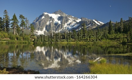Mt. Shuksan reflected in Picture Lake.  Mt. Baker/Snoqualmie National Forest, WA. - stock photo