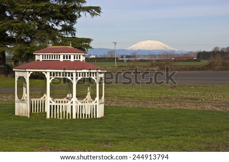 Mt. St. Helens farm fields and a gazebo in Suvie Island Oregon. - stock photo