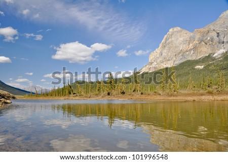 Mt Sukakpak reflects in tundra pond, Alaska - stock photo