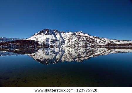 Mt. Tallac reflection in fallen leaf lake - stock photo