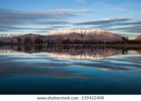 Mt Timpanogos Reflecting on Utah Lake - stock photo