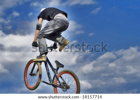 MTB racer jumping in the air - stock photo