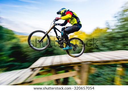 MTB rider in action. speed motion with bluried background, only bike in focus.  - stock photo