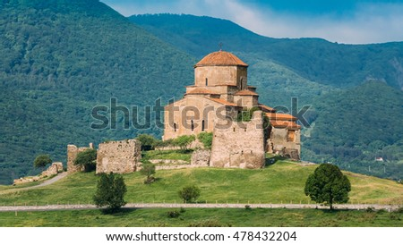 Mtskheta, Georgia. The Ancient World Heritage, Georgian Orthodox Jvari Monastery On The Spring Green Valley, Scenic Mountain Hills, Cloudy Sky Background.