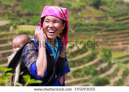 MU CANG CHAI, VIETNAM - MAY 16, 2014 - unidentified H'mong in Mu Cang Chai, Yen Bai, Vietnam at May 16, 2014. H'mong are the 8th largest ethnic group in Vietnam. - stock photo