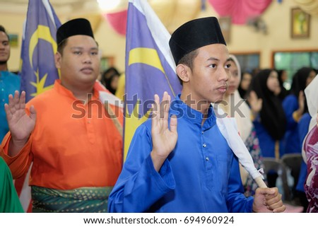 Muadzam Shah, Malaysia - August 7th, 2017: Malaysian college students with Malaysian Flag during the celebration of Hari Kemerdekaan, the Independence Day of Malaysia.