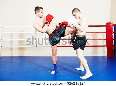 muai thai sportsman fighting at training boxing ring - stock photo