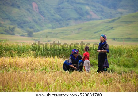 MUCANGCHAI, VIETNAM, September 19, 2016: H'mong ethnic minority kids near terraced rice field in Mucangchai, Vietnam. H'mong is the 8th largest ethnic group in Vietnam.