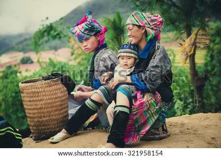 MUCANGCHAI, VIETNAM, SEPTEMBER 26, 2015: Hmong ethnic minority women with their children in Mu Cang Chai, Yen Bai. Mu Cang Chai is a district famous for many terraced rice fields.