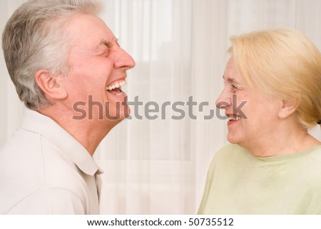 much laughing old man standing in front of women