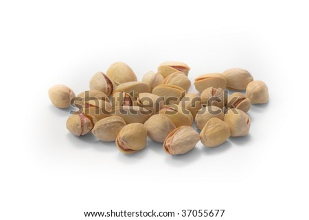 Much salty pistachioes on white background