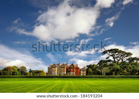Muckross House, County Kerry, Ireland - is a Tudor style mansion built in 1843 located on the small Muckross Peninsula between two of the lakes of Killarney and is today a popular tourist attraction - stock photo