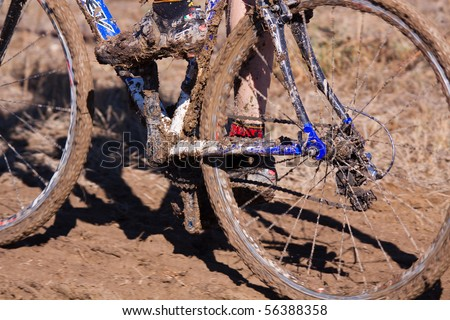 Mud build-up on cyclocross race bike - stock photo