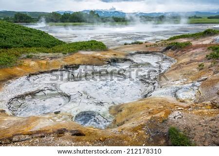 Mud cauldron in the volcanic caldera Uzon - Legendary Valley of Geysers, Kamchatka, Russia - stock photo