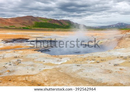 Mud pots in the geothermal area Hverir near lake Myvatn, Iceland