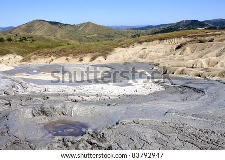 Mud volcano in Romania. - stock photo