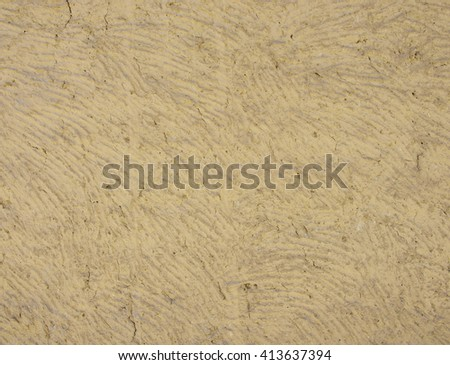Mud wall with cracks texture - stock photo