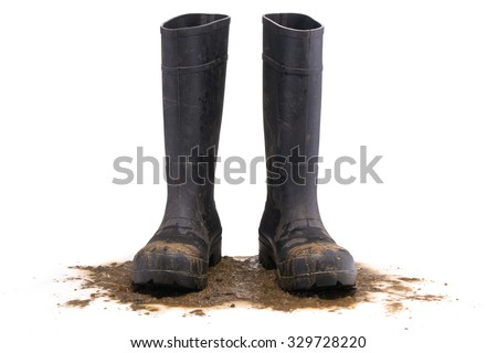 Muddy rubber boots front view isolated on white background - stock photo