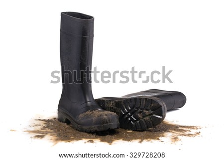 Muddy rubber fallen boots 3/4 view isolated on white background - stock photo