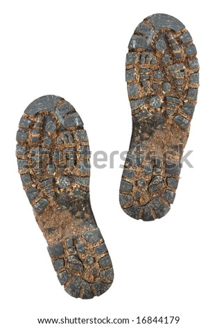 Muddy soles of hiking boots, isolated on white. - stock photo