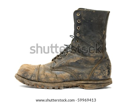 Muddy steelcap boots isolated on white