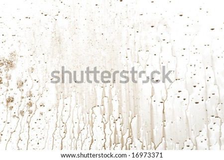 Muddy water drip patterns on a white background - stock photo