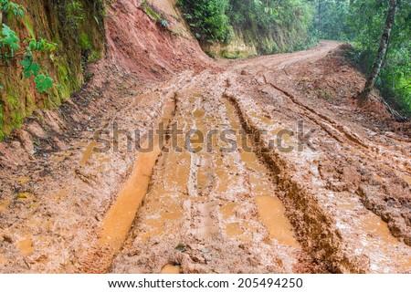 Muddy wet countryside road - stock photo