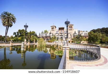 Mudejar Pavilion and pond at sunset. Placed in the Plaza de America, houses the Museum of Arts and Traditions of Sevilla, Spain. Built in 1928 for the Ibero-American Exposition of 1929