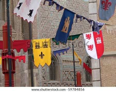 mudejar wall in Zaragoza behind flags and banners put up for a festival