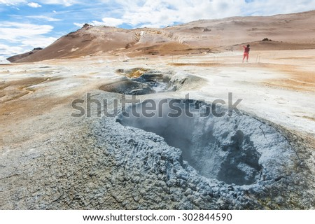 Mudpot in the geothermal area Hverir, Iceland. The area around the boiling mud is multicolored and cracked. HDR image - stock photo
