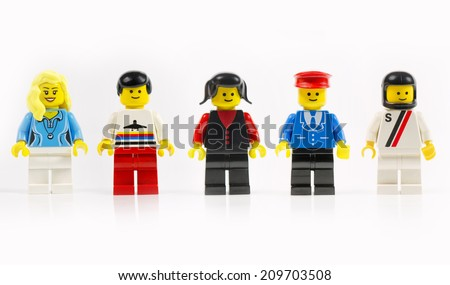 Muenster, Germany - June 18th 2014: A group of five various lego mini characters isolated on white. Lego is a popular line of construction toys manufactured by the Lego Group. - stock photo