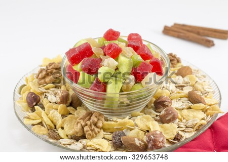 Muesli and dried fruit and cinnamon  served in glass bowls - stock photo