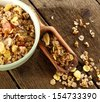 muesli and wooden spoon  - stock photo