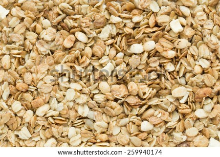 Muesli background texture with wheat and corn crisps, flakes and sunflower seeds - stock photo