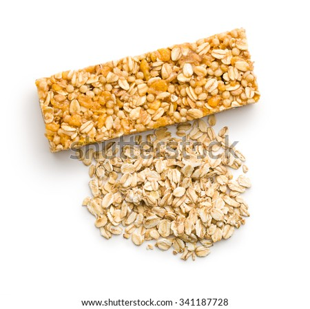 muesli bar and oat flakes on white background - stock photo