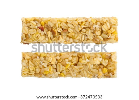 Muesli bar with apple, nuts and sugar isolated on white