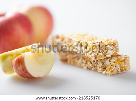 Muesli bar with apple piece - stock photo