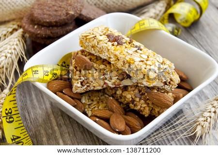 Muesli bars and almonds,diet concept - stock photo