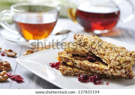 Muesli Bars on plate with nuts and dried fruits - stock photo