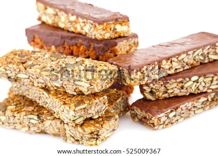Muesli bars with different nuts and seeds isolated on white background.