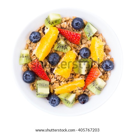 Muesli, fruit, berries in a bowl on a white background